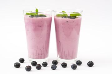 Fresh blueberry smoothie on white background