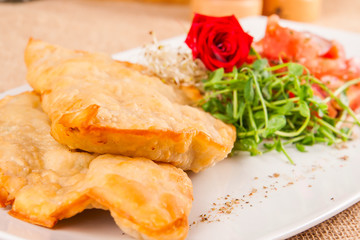 Pasties with tomato and herbs