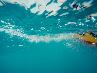Underwater view of a moving inflatable ring that floating in the water.