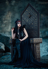 .dark evil queen sitting on a luxurious throne,dark boho, cosplay to the film SNOW WHITE AND THE HUNTSMAN ,wild Princess , vampire , hip toning , creative color.