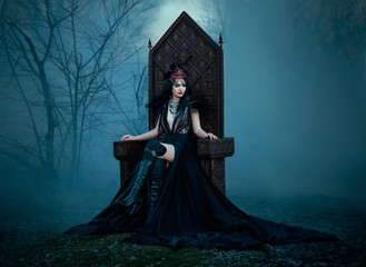 .dark evil queen sitting on a luxurious throne,dark boho, cosplay to the film SNOW WHITE AND THE HUNTSMAN ,wild Princess , vampire , hip toning , creative color.dark boho
