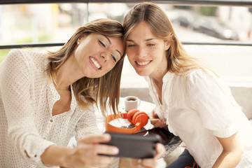 Women taking a self portrait with mobile phone