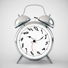 silver alarm clock twisted