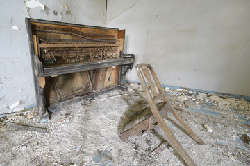 broken piano and chair in abbondoned house Lesvos Greece