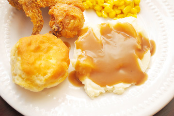 Mashed Potatoes & Gravy with a Biscuit Served as Side Dishes