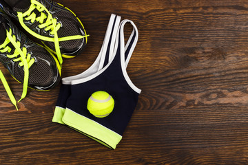 Sneakers, bottle and sports bra