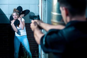 Pointing gun at kidnapper