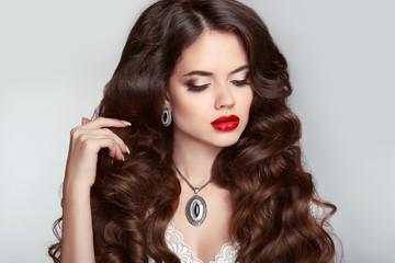 Beauty Makeup. Healthy hair. Beautiful girl with long wavy hairs