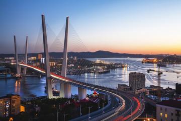 Panorama of Vladivostok at sunset, Far East Russia. Golden bridge. Wall mural
