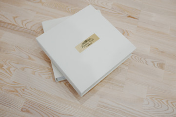 Wedding photo book and album on wooden background