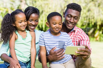 Happy family looking a smartphone