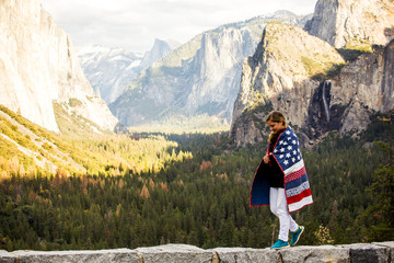 Woman walking with American Flag quilt at Yosemite National Park