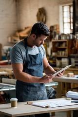 carpenter using his tablet