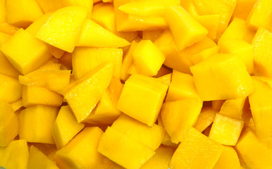 Mango diced on the skin closeup square composition