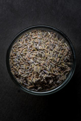 Dried Lavender in Glass Bowl on Black Background