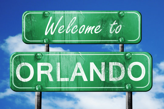 orlando vintage green road sign with blue sky background