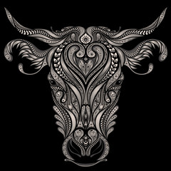 Abstract vector head of cow on a black background