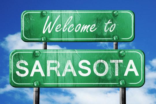 sarasota vintage green road sign with blue sky background