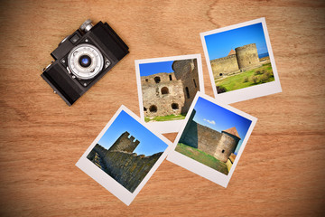 camera and photos with medieval castle