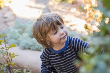 Caucasian boy playing in garden