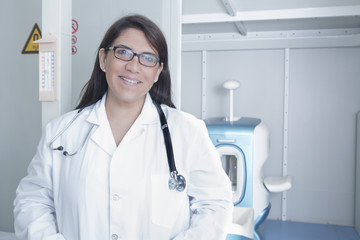 Portrait of female doctor smiling while standing in hospital