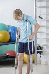 Rehabilitation of young boy walking