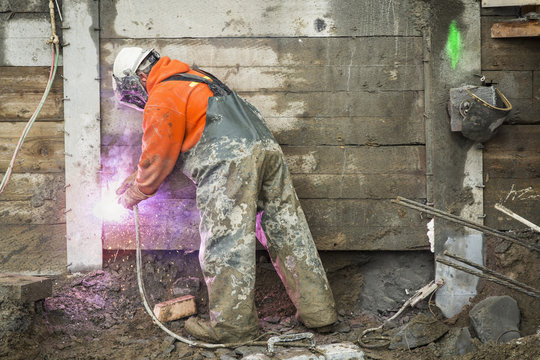 Construction worker welding at construction site