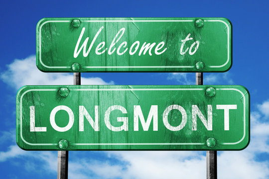 longmont vintage green road sign with blue sky background