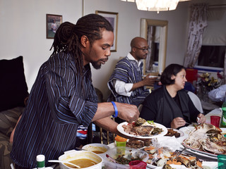 Man serving food at holiday dinner