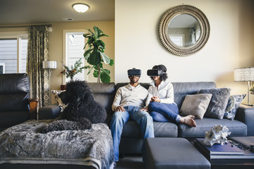 Couple using virtual reality goggles