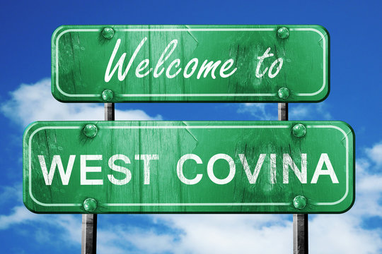 west covina vintage green road sign with blue sky background