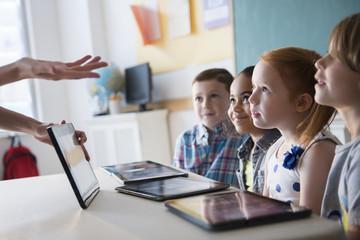 Teacher demonstrating tablet for students