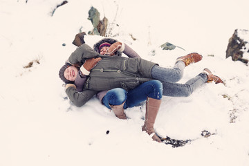 Caucasian teenage girls playing in snow