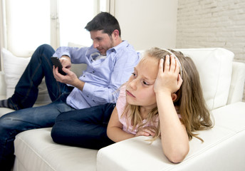internet addict father using mobile phone ignoring little sad daughter bored lonely and depressed