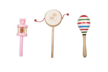Wooden rattles and drum on a white studio background