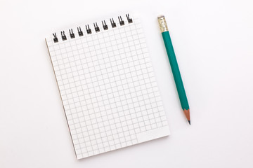 notebook and pencil on a white background