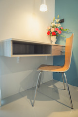 Table with wooden chair in modern working area at home