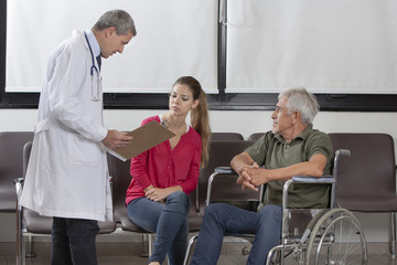 Doctor consulting with a patient and his family