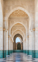The corridor in Grand Mosque of Hassan II with blue sky