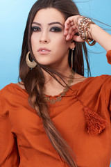 Portrait of beautiful glamor hipster young hippie woman in studio.