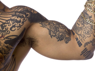 cropped image of a man with tattoo on his biceps.