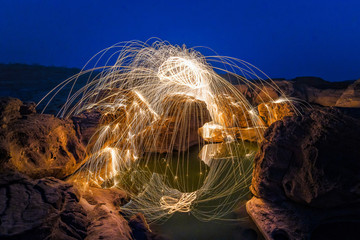 Long exposure capture of Burning steel wool being spun