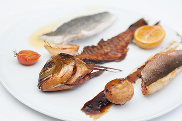 Smoked Fish Bare bone served on a white restaurant plate