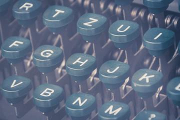 vintage typewriter keyboard closeup - retro filter