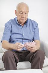 senior man playing cards stock image