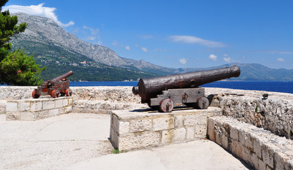 Cannons at medieval fortress in Korcula town, Korcula, Croatia, Europe.