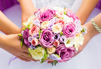 Beautiful wedding bouquet in hands of the bride close-up