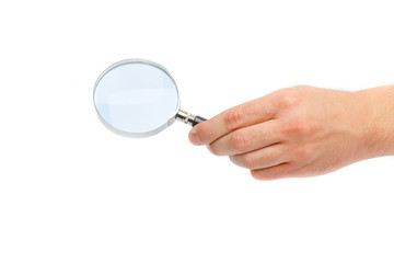 Magnifying glass in a hand