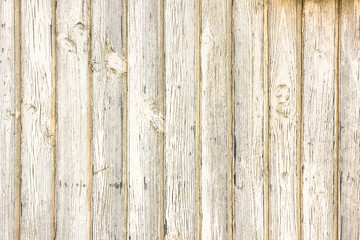 Peel yellow paint wooden wall background.