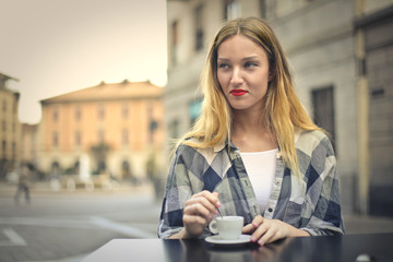 Girl sitting at the cafe